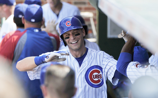 Hi-res-171229960-ryan-sweeney-of-the-chicago-cubs-is-greeted-after_crop_650