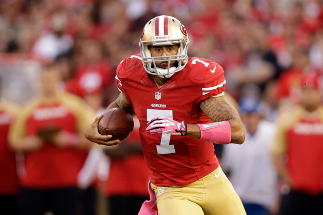 Hi-res-183478264-colin-kaepernick-of-the-san-francisco-49ers-runs-the_crop_650