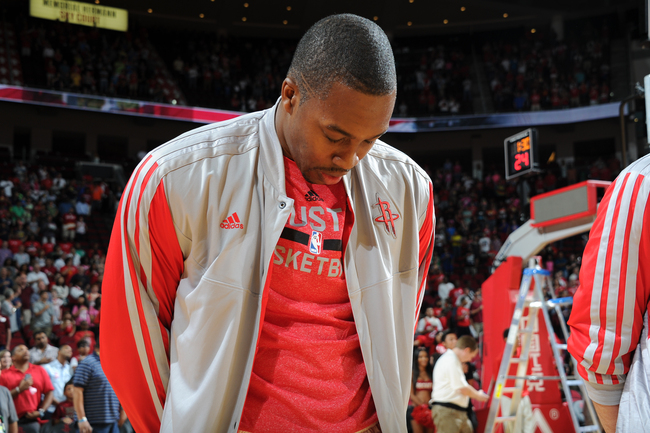 Hi-res-183643388-dwight-howard-of-the-houston-rockets-stands-for-the_crop_650