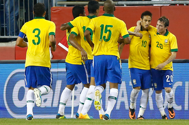 Hi-res-180263199-neymar-of-brazil-celebrates-with-teammate-bernard_crop_650