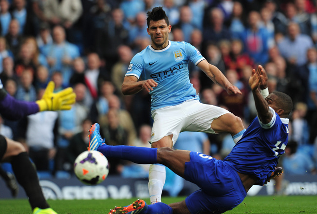Hi-res-183153407-sergio-aguero-of-manchester-city-shoots-past-sylvain_crop_650x440