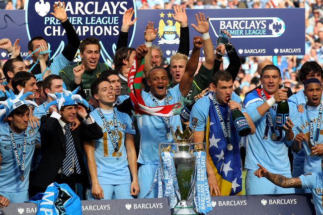 Hi-res-144369781-the-manchester-city-players-celebrate-with-the-trophy_crop_650