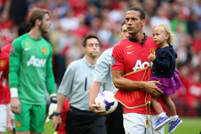 Hi-res-175879308-rio-ferdinand-of-manchester-united-walks-out-with-his_crop_650