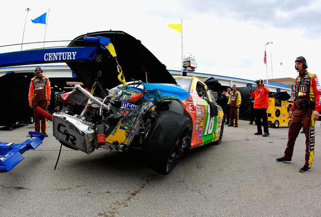 Hi-res-183460610-kyle-busch-driver-of-the-m-ms-toyota-is-towed-in-to-the_crop_650x440