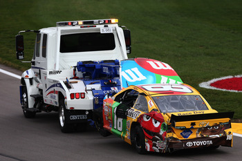 Hi-res-183460022-the-m-ms-toyota-of-kyle-busch-is-towed-to-the-garage_display_image