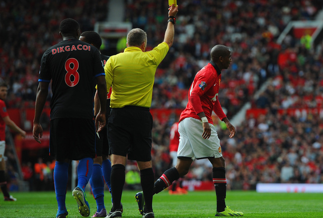 Hi-res-180572930-ashley-young-of-manchester-united-is-booked-by-referee_crop_650x440