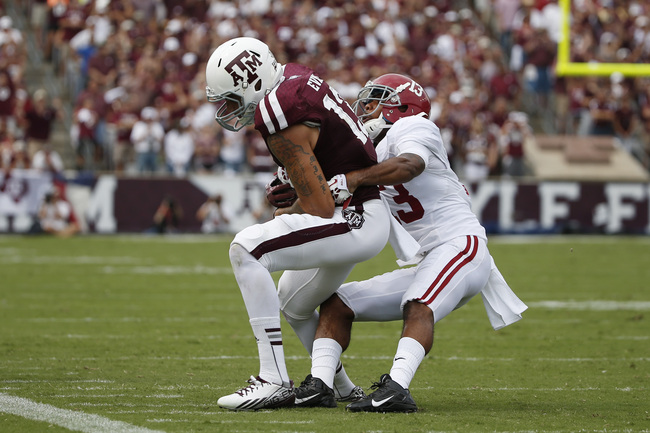 Hi-res-180548734-mike-evans-of-the-texas-a-m-aggies-is-tackled-by-deion_crop_650