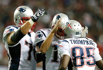 Hi-res-182451603-tom-brady-and-sebastian-vollmer-congratulates-kenbrell_display_image