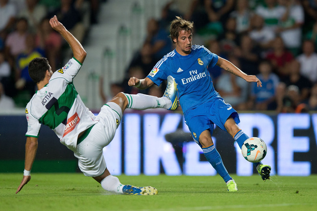 Hi-res-181809153-fabio-coentrao-of-real-madrid-cf-competes-for-the-ball_crop_650