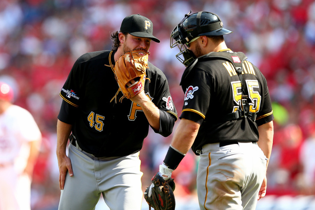 Hi-res-183108628-gerrit-cole-talks-with-catcher-russell-martin-of-the_crop_650