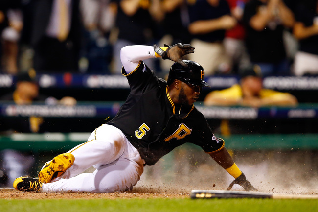 Hi-res-183468035-josh-harrison-of-the-pittsburgh-pirates-scores-as-a_crop_650
