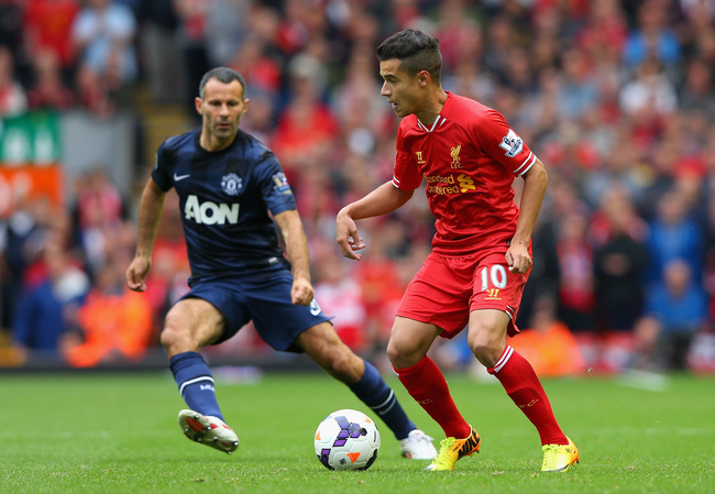 Hi-res-179184337-coutinho-of-liverpool-competes-with-ryan-giggs-of_crop_650