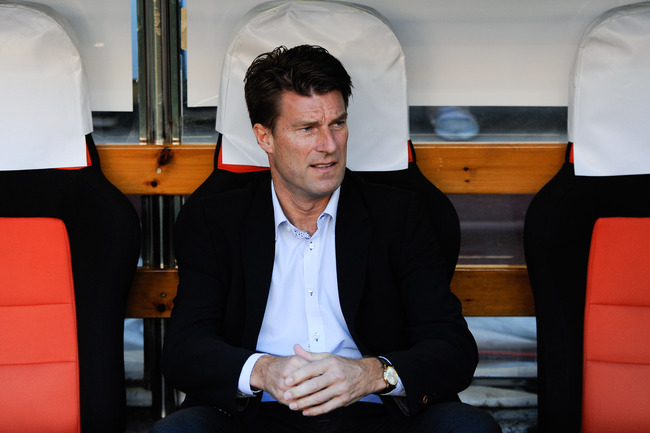 Hi-res-181173446-manager-michael-laudrup-of-swansea-city-looks-on-during_crop_650