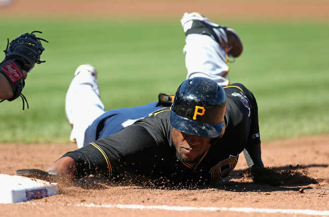 Hi-res-181801929-starling-marte-of-the-pittsburgh-pirates-dives-back-to_crop_650