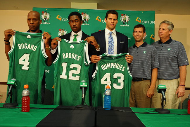 Hi-res-173516643-keith-bogans-marshon-brooks-and-kris-humphries_crop_650