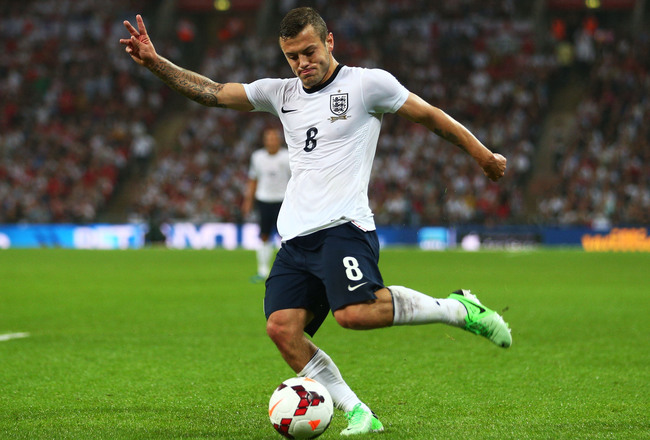 Hi-res-176550230-jack-wilshere-of-england-crosses-the-ball-during-the_crop_650x440