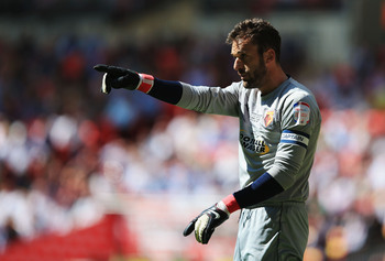 Hi-res-169558860-manuel-almunia-of-watford-signals-during-the-npower_display_image
