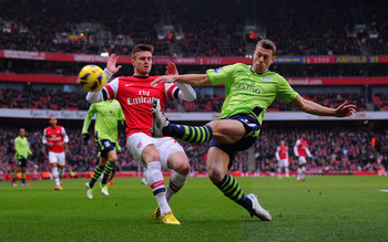 Hi-res-162424554-nathan-baker-of-villa-in-action-with-carl-jenkinson-of_display_image
