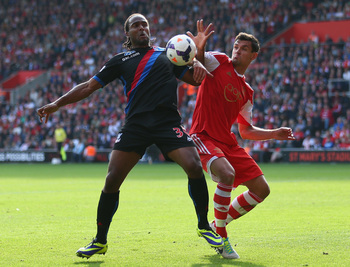 Hi-res-182112662-cameron-jerome-of-crystal-palace-battles-for-ball-with_display_image