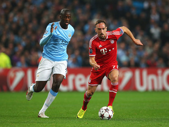 Hi-res-182936192-franck-ribery-of-muenchen-takes-on-yaya-toure-of_display_image