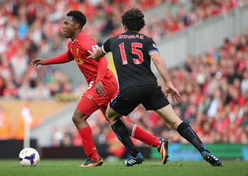 Hi-res-183158589-daniel-sturridge-of-liverpool-moves-away-from-mile_display_image