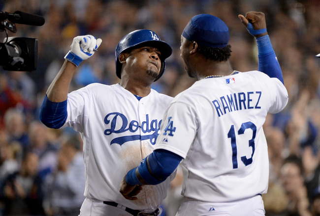 Hi-res-183609404-juan-uribe-of-the-los-angeles-dodgers-celebrates-with_crop_650x440