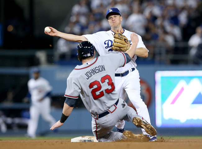 Hi-res-183603171-mark-ellis-of-the-los-angeles-dodgers-throws-the-ball_crop_650