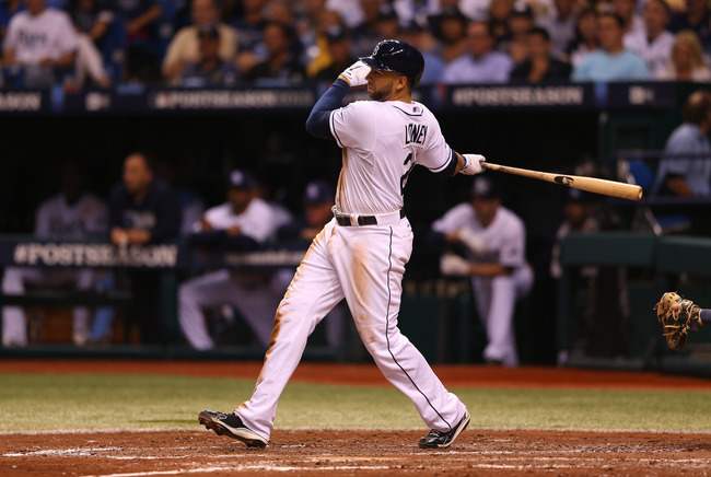 Hi-res-183592956-james-loney-of-the-tampa-bay-rays-hits-a-single-in-the_crop_650