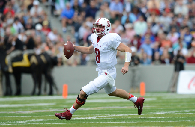 Hi-res-180536370-quarterback-kevin-hogan-of-stanford-runs-for-a-first_crop_650