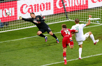 Nicklas Bendtner heads home one of his two goals against Portugal at Euro 2012.