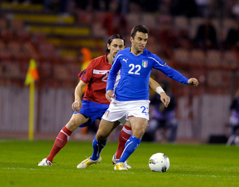 Giuseppe Rossi battles against Serbia in qualification for Euro 2012.