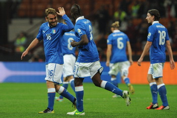 154389327-mario-balotelli-of-italy-celebrates-his-goal-with-team_display_image