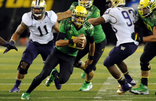 Hi-res-153842203-quarterback-marcus-mariota-of-the-oregon-ducks_crop_650