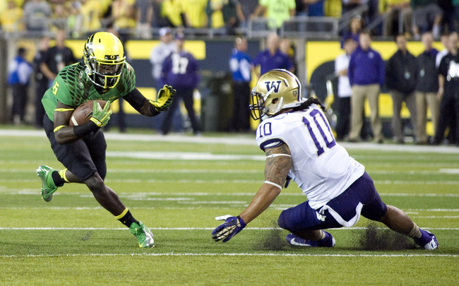 Hi-res-153597543-running-back-deanthony-thomas-of-the-oregon-ducks-heads_crop_650