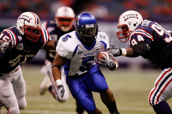 Hi-res-78622815-joseph-doss-of-the-memphis-university-tigers-is-tackled_display_image