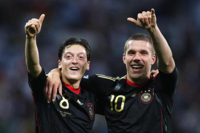 Hi-res-102607252-mesut-oezil-and-lukas-podolski-of-germany-celebrate_crop_650