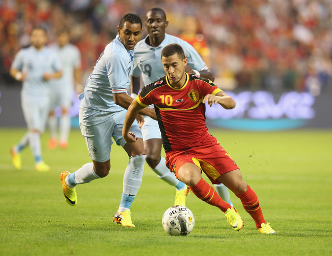 Hi-res-176541546-eden-hazard-of-belgium-moves-away-from-dimitri-payet_crop_650