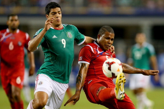 Hi-res-174373365-roman-torres-of-panama-dribbles-the-ball-against-raul_crop_650