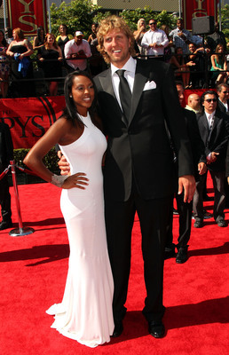 Hi-res-118987522-player-dirk-nowitzki-arrives-with-girlfriend-jessica_display_image