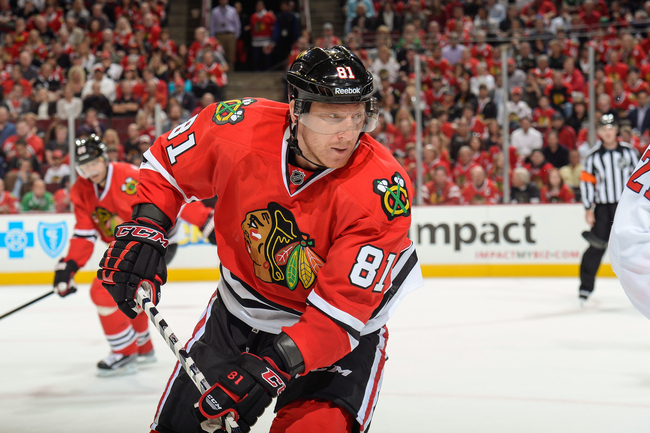 Hi-res-183647166-marian-hossa-of-the-chicago-blackhawks-watches-for-the_crop_650