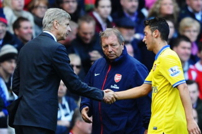 180530571-arsenal-manager-arsene-wenger-shakes-hands-with-mesut_crop_650