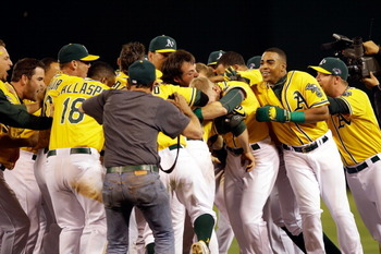 183201593-the-oakland-athletics-celebrate-fter-defeating-the_display_image