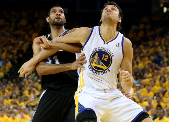 168914802-andrew-bogut-of-the-golden-state-warriors-fights-for_crop_650