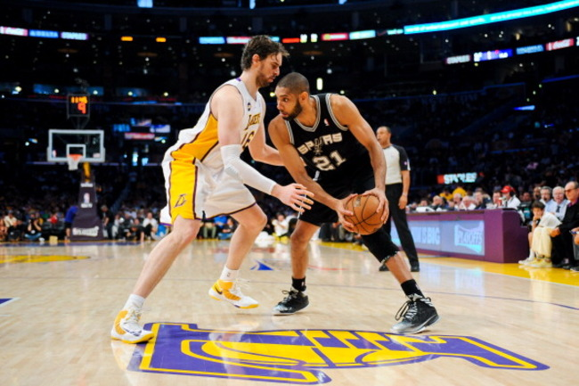 167734192-tim-duncan-of-the-san-antonio-spurs-controls-the-ball_crop_650
