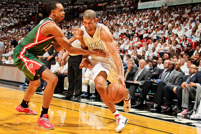 Hi-res-167288078-shane-battier-of-the-miami-heat-drives-against-john_crop_650