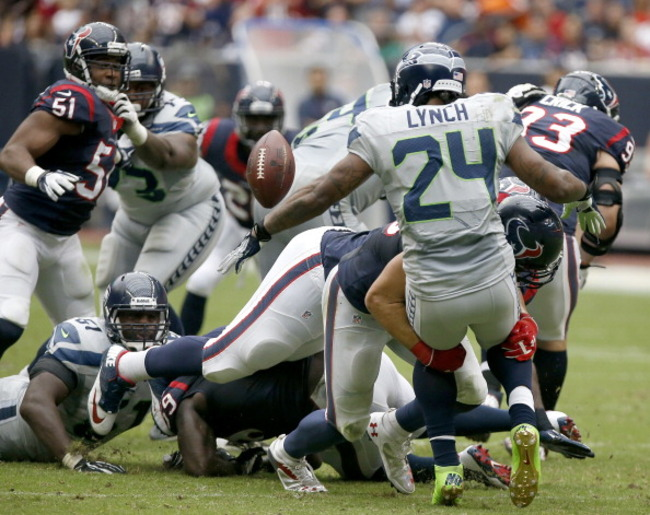182305710-marshawn-lynch-of-the-seattle-seahawks-fumbles-the-ball_crop_650