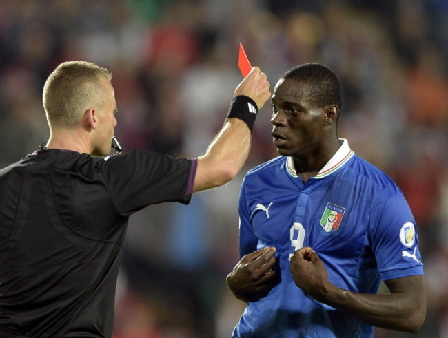 170133136-mario-balotelli-of-italy-reacts-as-he-is-shown-a-red_crop_650