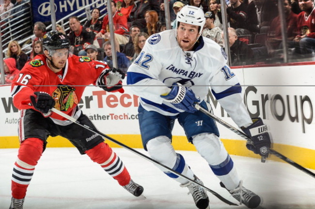 183196114-ryan-malone-of-the-tampa-bay-lightning-takes-the-puck_crop_650