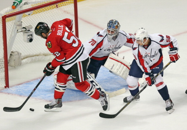183118391-brandon-bollig-of-the-chicago-blackhawks-puts-a-shot_crop_650