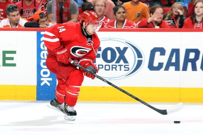 183707808-nathan-gerbe-of-the-carolina-hurricanes-carries-the_crop_650